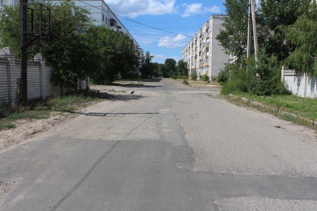 В Северодонецке продолжают латать ямы на дорогах (фото), фото-10
